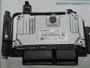 блок управления двигателем впрыскового мотора.